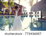 woman standing at resort near... | Shutterstock . vector #773436007