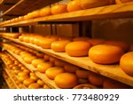 rows of cheese pieces on wooden ... | Shutterstock . vector #773480929
