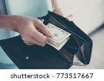 woman hand holding american... | Shutterstock . vector #773517667