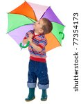 Little boy holding colored umbrella and looking to sky - stock photo