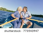 senior couple kissing on a boat.... | Shutterstock . vector #773543947