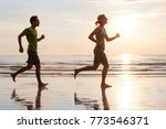 happy young couple jogging on... | Shutterstock . vector #773546371
