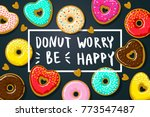donuts with donut worry be... | Shutterstock .eps vector #773547487