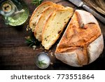 rustic loaf of homemade bread... | Shutterstock . vector #773551864