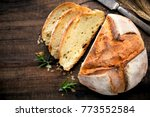 rustic loaf of homemade bread... | Shutterstock . vector #773552584