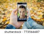 man in the park unlocking...   Shutterstock . vector #773566687