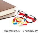 stack of books and pills ... | Shutterstock . vector #773583259