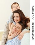 happy parents with their son at ... | Shutterstock . vector #77359891