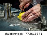 bartender cutting lemon at the... | Shutterstock . vector #773619871