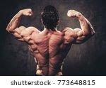 man showing his muscular body.   Shutterstock . vector #773648815