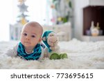 little cute baby boy  playing...   Shutterstock . vector #773695615
