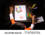 top view of a cute boy drawing... | Shutterstock . vector #773705701