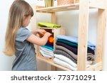 the girl is measuring her... | Shutterstock . vector #773710291