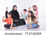 arab family sitting at home... | Shutterstock . vector #773718589