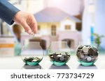 hand of businessman put coin to ... | Shutterstock . vector #773734729