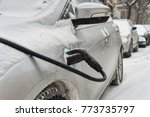 electric car getting charged in ... | Shutterstock . vector #773735797