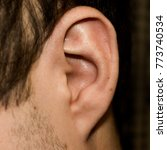 male ear. adherent earlobe... | Shutterstock . vector #773740534