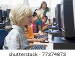 children at computer terminals... | Shutterstock . vector #77374873