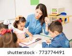 pretty young preschool teacher... | Shutterstock . vector #773774491