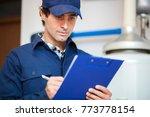 technician servicing an hot... | Shutterstock . vector #773778154