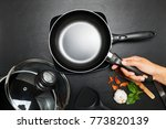 top view frying pan and pot on... | Shutterstock . vector #773820139