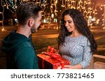 man giving present to his...   Shutterstock . vector #773821465