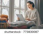 happy beautiful woman watching... | Shutterstock . vector #773830087