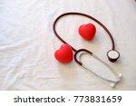 stethoscope  red heart model on ...   Shutterstock . vector #773831659