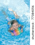 Summer vacation - little girl in blue water - stock photo