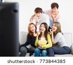 young group sitting on sofa... | Shutterstock . vector #773844385