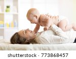 happy family mother playing... | Shutterstock . vector #773868457