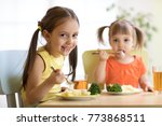 kids eating healthy food in... | Shutterstock . vector #773868511