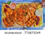 chicken  pork and rice on a... | Shutterstock . vector #773875249