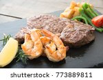 rib eye steak and grilled... | Shutterstock . vector #773889811