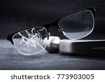 broken glasses with a metal... | Shutterstock . vector #773903005
