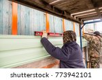 workers walling the house with... | Shutterstock . vector #773942101