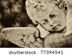 Old Statue Of An Infant Angel...