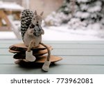 Squirrel Sitting On Wood With...