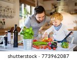young father with a toddler boy ... | Shutterstock . vector #773962087