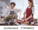 smiling granddaughter cutting... | Shutterstock . vector #773968021