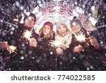 group of young people with... | Shutterstock . vector #774022585