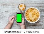 male hand holding smartphone... | Shutterstock . vector #774024241