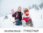happy playful kid in snow | Shutterstock . vector #774027469