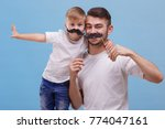dad and his son are standing... | Shutterstock . vector #774047161