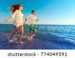 happy young couple enjoying the ... | Shutterstock . vector #774049591