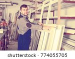 laughing workman inspecting pvc ...   Shutterstock . vector #774055705