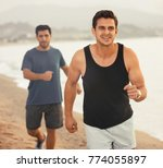 smiling sportsmen are joggning... | Shutterstock . vector #774055897