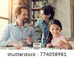 time with family. delighted... | Shutterstock . vector #774058981