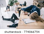 tired business colleagues... | Shutterstock . vector #774066754
