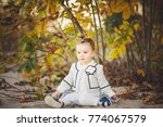 smiling baby girl sdending time ... | Shutterstock . vector #774067579